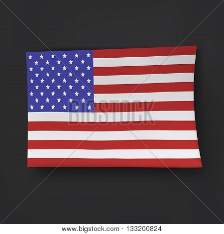 Paper American flag on the black background.