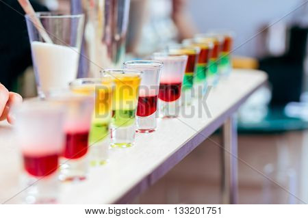 Colorful Liquor Shots With Alcohol In Cocktail Bar