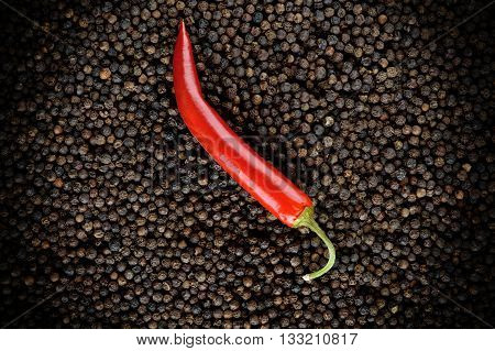 image of closeup red peppers on black peppercorns