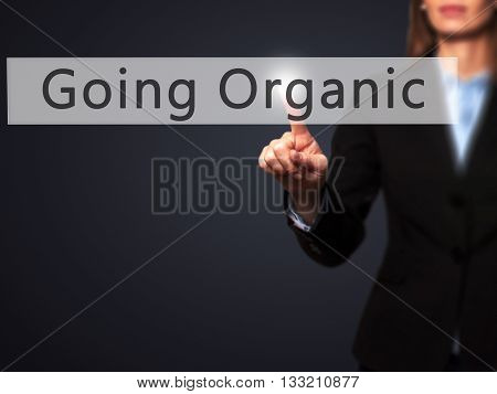Going Organic - Businesswoman Hand Pressing Button On Touch Screen Interface.