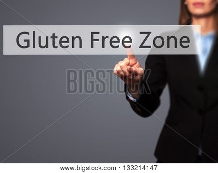Gluten Free Zone - Businesswoman Hand Pressing Button On Touch Screen Interface.