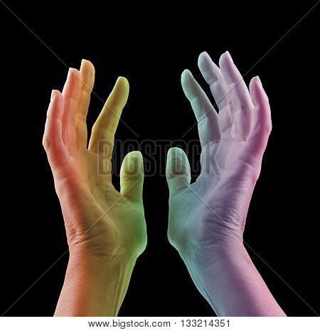 Absorbing Color Light Therapy - Female hands reaching up with colored light projected onto skin in rainbow range of colors - red orange, yellow, green blue, magenta, against a black background