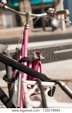 pink bicycle cruiser without seat on parking
