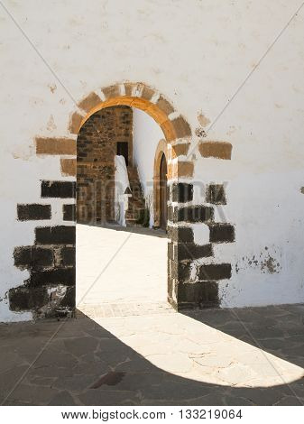 Shadow cast through old stone archway in Lanzarote Spain