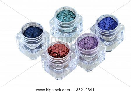 bright and colorful eyeshadows in box on white background isolated