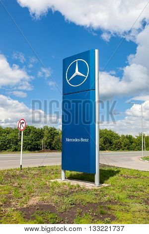 SAMARA RUSSIA - MAY 22 2016: Official dealership sign of Mercedes-Benz in summer sunny day. Mercedes-Benz is a German automotive manufacturer