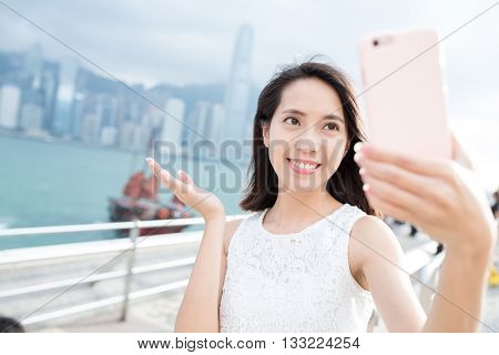 Woman taking self image at Victoria Harbor