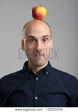 Bald Man With An Apple On His Head