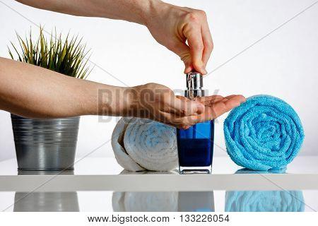 Men Hands On Soap Dispenser In The Bathroom