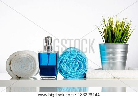 Decorated White Bath With Blue Soap Dispenser