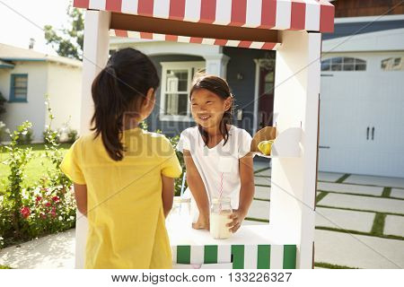 Two Girls At Home Made Lemonade Stall