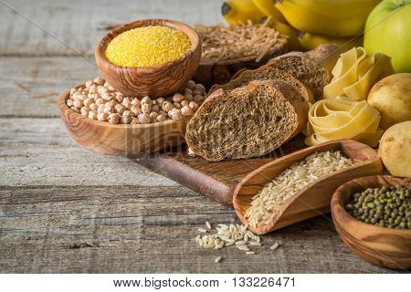 Selection of comptex carbohydrates sources on wood background, copy space