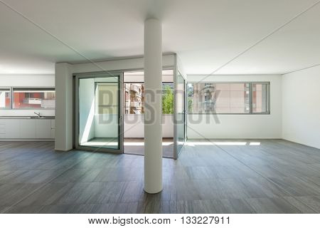 Interior of empty apartment, wide room with inside terrace