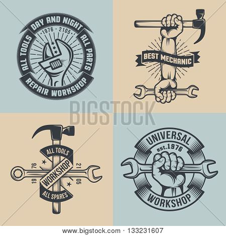 Logo mechanical repair shop in vintage style. Hands with tools.