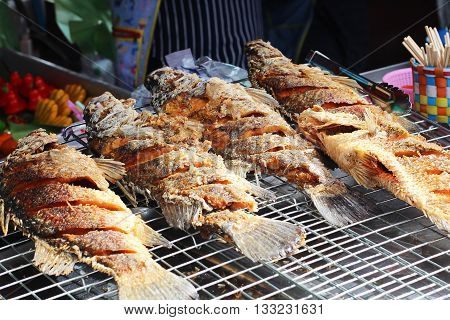 Fried snapper fish on the tray at the market for sell