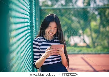 asian girl and computer tablet in hand standing with toothy smiling face use for people and internet connecting communication in modern digital lifestyle