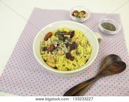 Millet porridge with nuts, raisins, pumpkin seeds and chia seeds