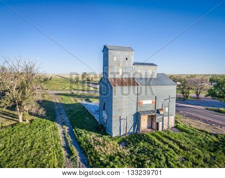 GROVER,  CO, USA - JUNE4, 2016:  Historic Grover Grain Elevator (circa 1916),  a well-preserved example of cribbed construction in Pawnee Grassland Region with still visible railroad right-of-way.