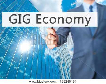 Gig Economy - Businessman Hand Holding Sign