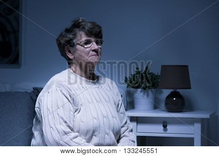 Elder lady is very lonely and gloomy at her house