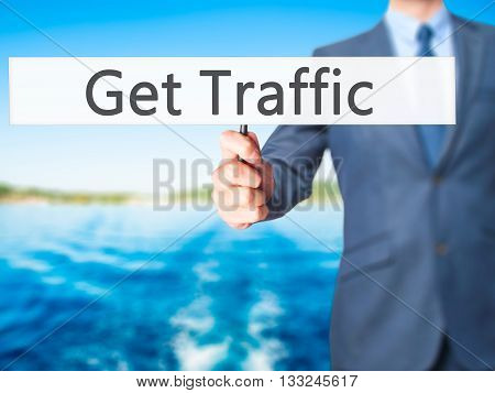 Get Traffic - Businessman Hand Holding Sign
