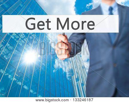 Get More - Businessman Hand Holding Sign