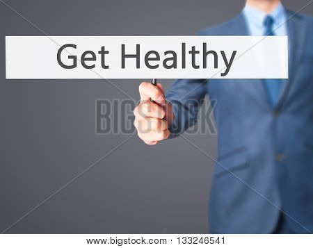 Get Healthy - Businessman Hand Holding Sign