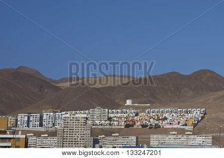 Colourful residential buildings in the Atacama Desert in Antofagasta on the Pacific coast of Chile.