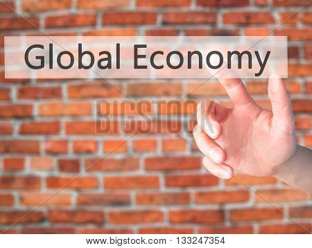 Global Economy - Hand Pressing A Button On Blurred Background Concept On Visual Screen.