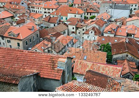 KOTOR MONTENEGRO - SEPTEMBER 21 2015: Top view of roofs of Old town of Kotor Montenegro