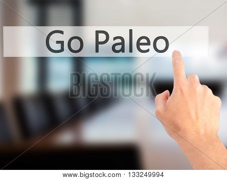 Go Paleo - Hand Pressing A Button On Blurred Background Concept On Visual Screen.
