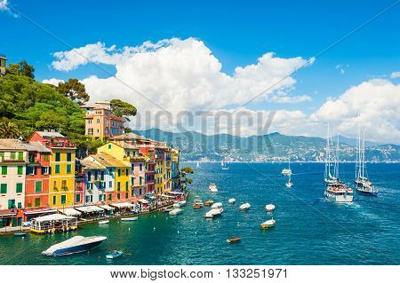 Beautiful sea coast with boats and colorful houses in Portofino Italy