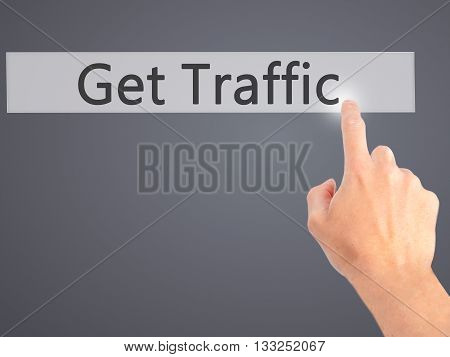 Get Traffic - Hand Pressing A Button On Blurred Background Concept On Visual Screen.