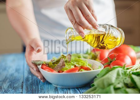 Preparing Light Vegetarian Salad With Lettuce, Tomatoes And Cucumber