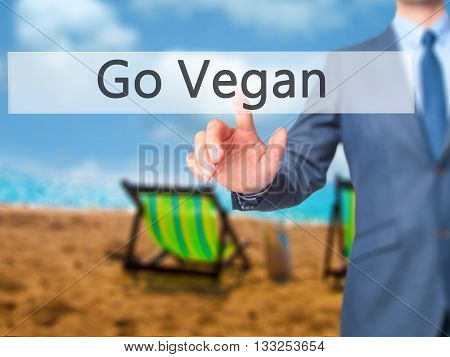 Go Vegan - Businessman Hand Pressing Button On Touch Screen Interface.