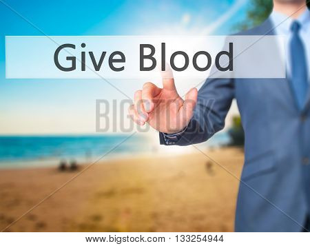 Give Blood - Businessman Hand Pressing Button On Touch Screen Interface.