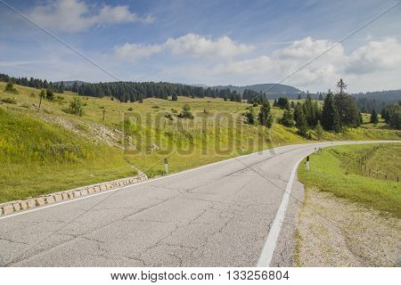 Road Along A Mountain Landscape. Italian Alps.