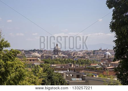 Cityscape of Rome Italy in sunlight with Saint Peter Basilica in the background