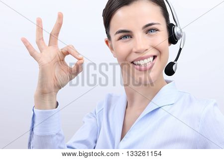 customer service operator smiling woman with headset ok hand sign isolated on white background