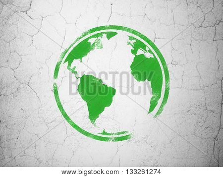 Studying concept: Green Globe on textured concrete wall background