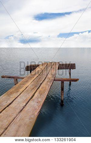 Wood bridge lonely at the vast ocean.