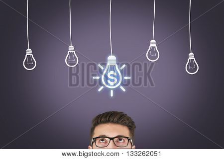 Portrait thinking human in glasses looking up with light idea bulb finance above head isolated on Virtual Screen