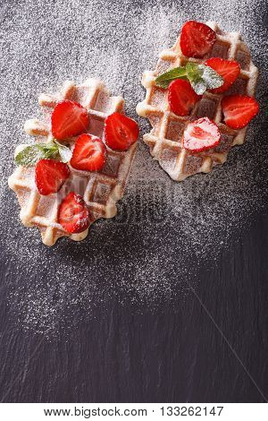 Tasty Waffles With Fresh Strawberries, Powdered Sugar Close-up On The Slate. Vertical Top View