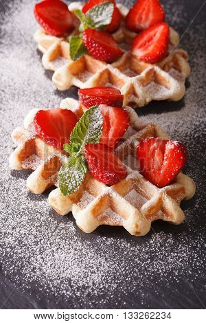 Waffles With Fresh Strawberries And Mint Close-up On The Slate. Vertical