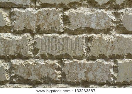 masonry of natural stone with a ragged edge, travertin