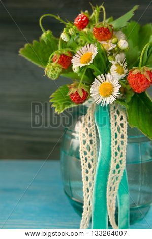 wild strawberry with flowers in the pot