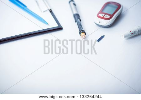 document writing data from glucometer to medical form result of measurement sugar concept for measuring sugar level