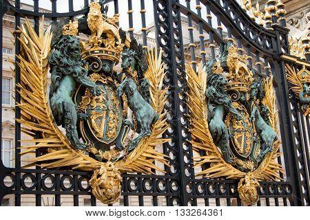 London United Kingdom - June 5th 2016: The UK Royal Coat of Arms on the gates of Buckingham Palace London UK.