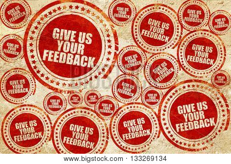 give us your feedback, red stamp on a grunge paper texture