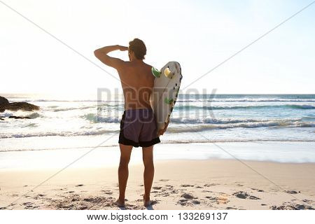 Surfer Looking At Waves In The Sea